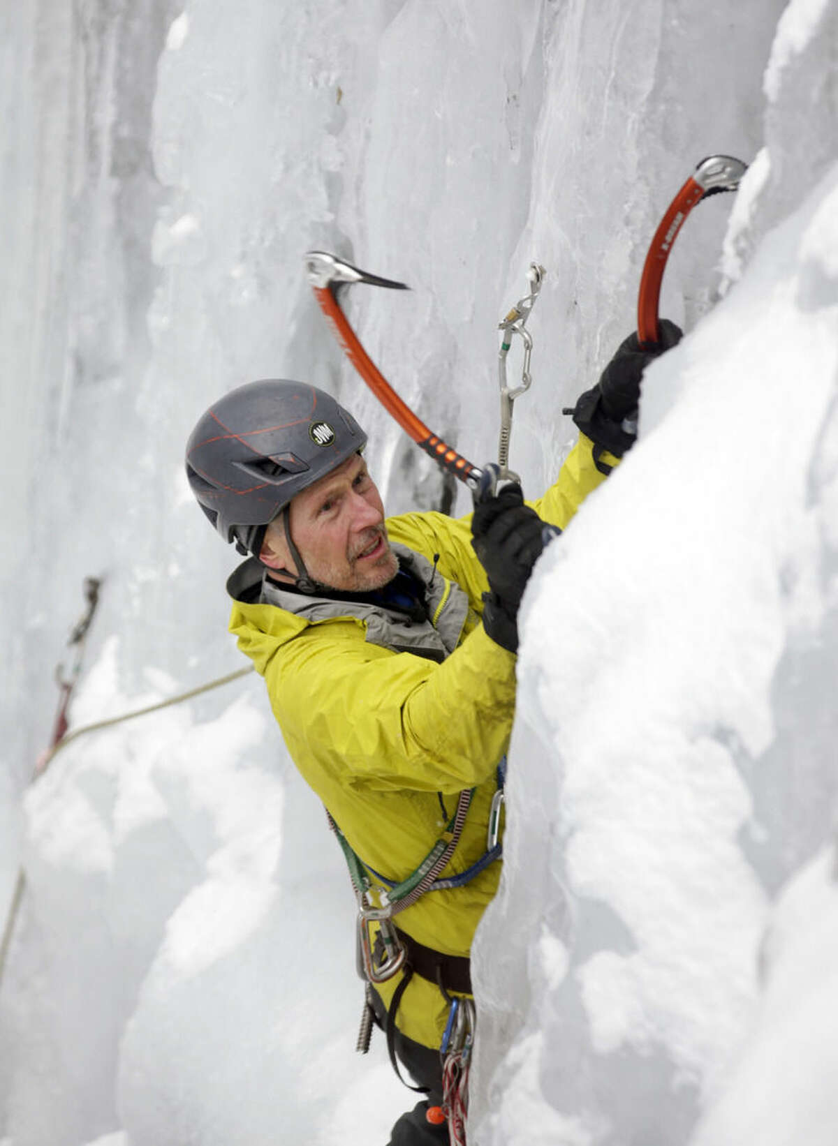 In this Wednesday, Feb. 10, 2016 photo, ice climber Don Mellor climbs Pitchoff Quarry in Keene, N.Y. Mellor has been scaling Adirondack ice for 38 winters and he's still wary. Climbers can slip on the glistening walls. Ice can crack and give way. Mistakes can be costly. (AP Photo/Mike Groll)