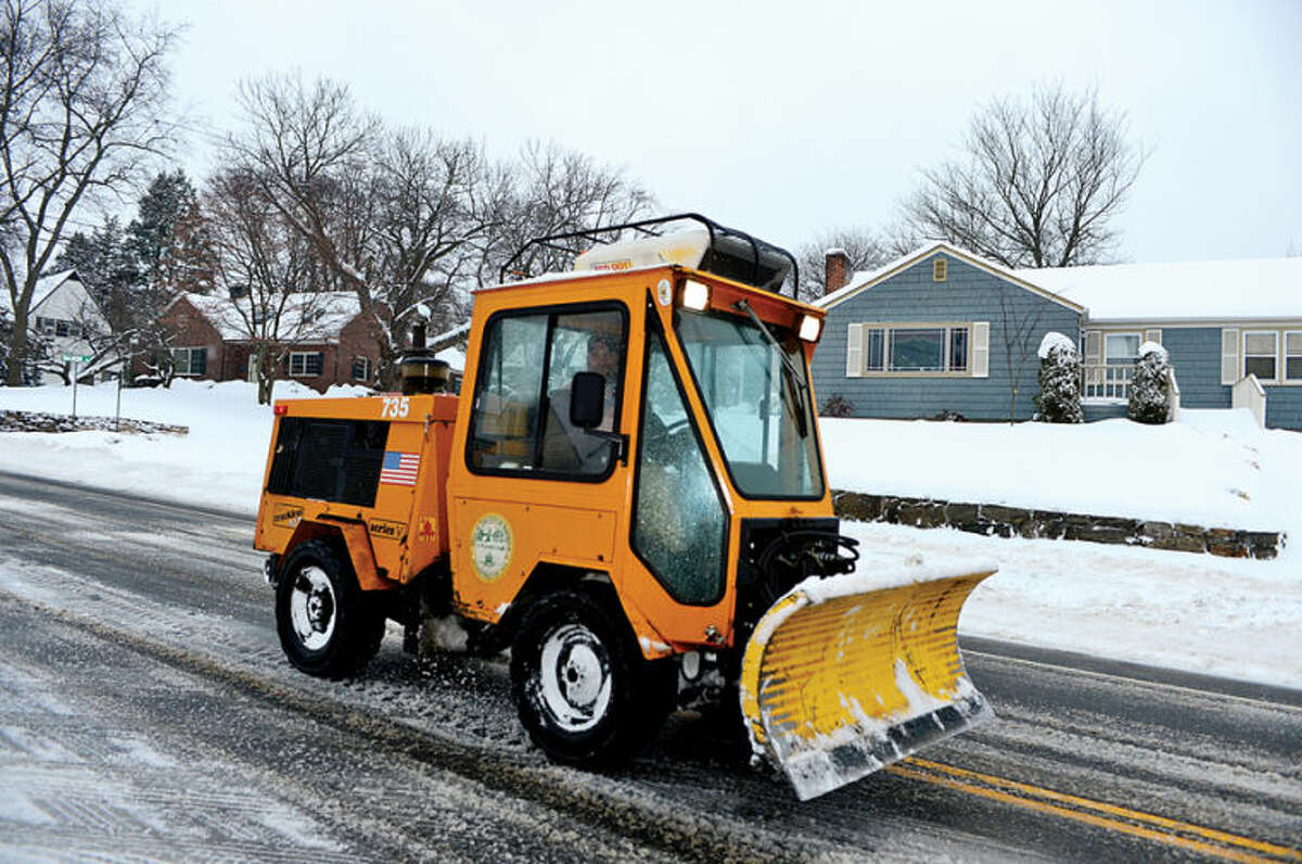 Hour photo / Erik Trautmann Norwalk DPW clears the streets following the recent winter storm that left 5 inches of wet snow for commuters to deal with Wednesday morning.