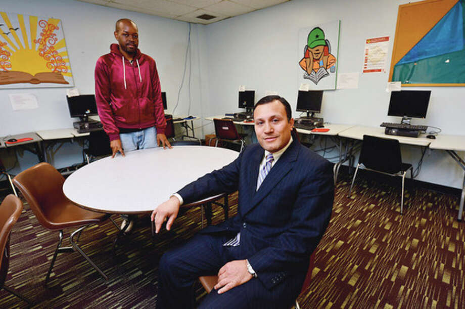 Hour photo / Erik TrautmannCouncilman Warren A. Pena, named chairman of South Norwalk Community Center, is shown with program coordinator Termaine Bookhart. The center's stature and presence at 98 South Main St. may have been muscled to the background over the years by fellow tenant Norwalk Economic Opportunity Now. / (C)2012, The Hour Newspapers, all rights reserved