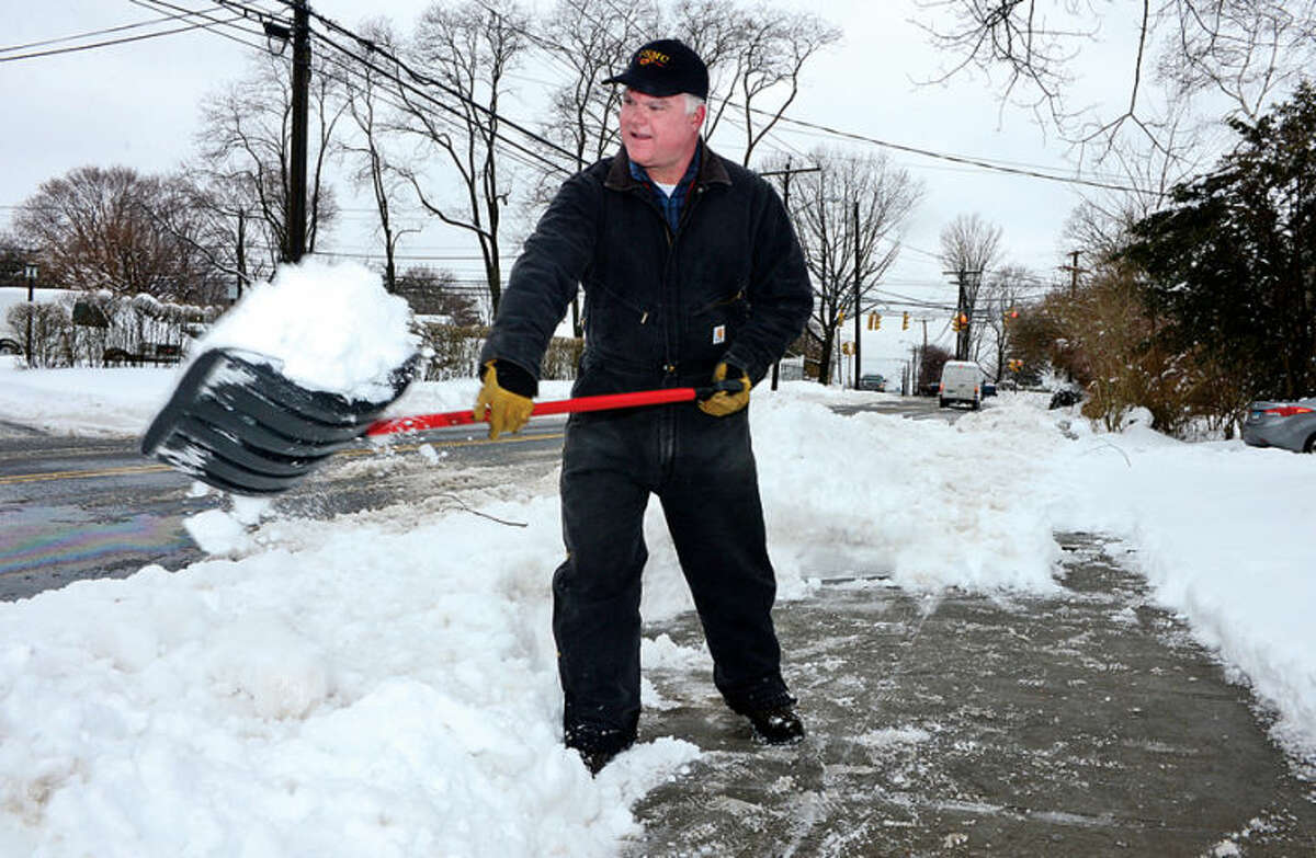 Hour photo / Erik Trautmann Jim O'Leary shovels the walk in front of his home on Hamilton Ave in Stamford following the recent winter storm that left 5 inches of wet snow Wednesday morning.