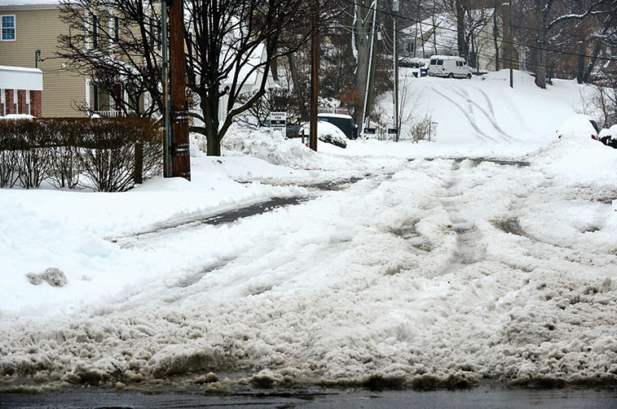 Hour photo / Erik Trautmann Some Norwalk streets were still in need of plowing in the afternoon following the storm that left 5 inches of wet snow Wednesday morning.