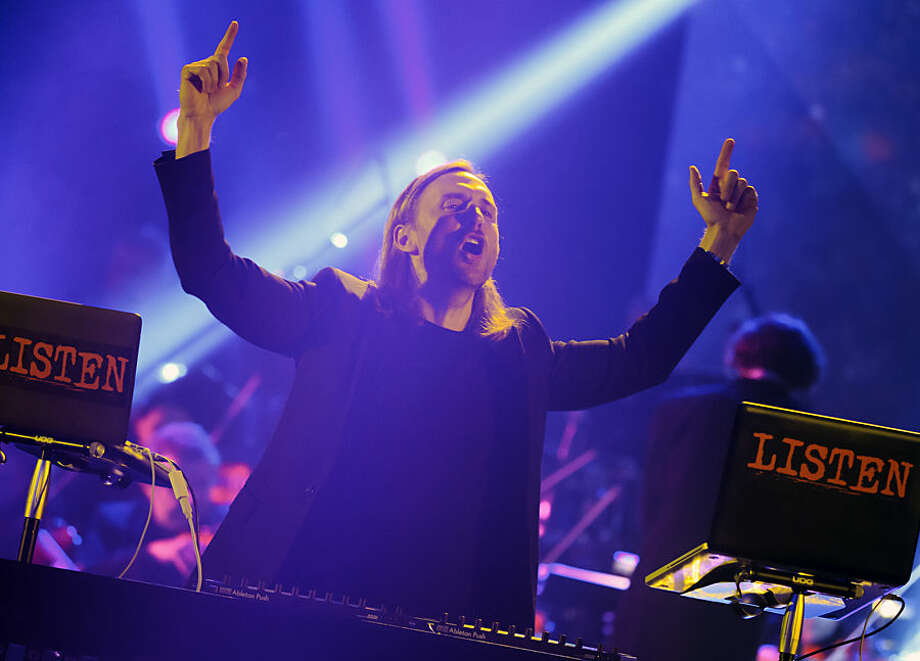 French DJ David Guetta performs on stage during the 30th Victoires de la Musique, annual French music awards ceremony, Friday, Feb. 13, 2015, in Paris, France. (AP Photo/Jacques Brinon)