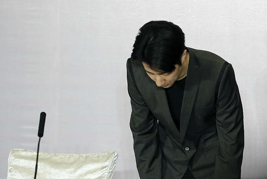 Hong Kong actor Jaycee Chan bows his head as he arrives for a news conference at a hotel in Beijing, Saturday, Feb. 14, 2015. Chan, the son of actor Jackie Chan, apologized to the public Saturday and asked for a second chance following his release from a six-month jail sentence for allowing people to use marijuana in his apartment. (AP Photo/Andy Wong)