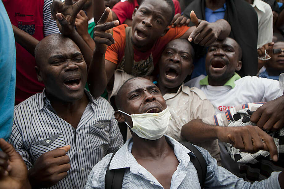 Protesters chant anti-government slogans at a protest demanding the government lower fuel prices, in Port-au-Prince, Haiti, Friday, Feb. 13, 2015. Students marched through Haiti's capital to demand lower gas prices and the ouster of President Michel Martelly. (AP Photo/Dieu Nalio Chery)