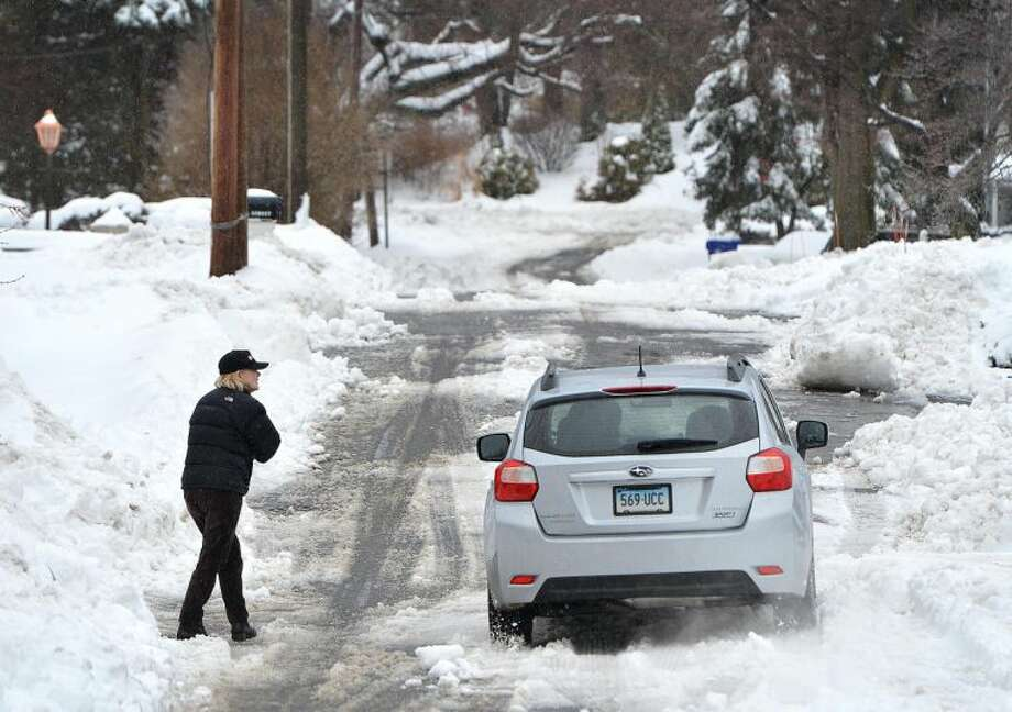 Hour Photo/Alex von Kleydorff Walk or drive, either way Vail St was difficult to navigate on Wednesday