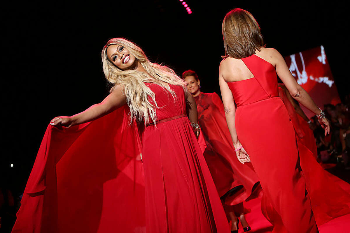 In this Thursday, Feb. 12, 2015 photo released by Starpix, Laverne Cox walks the runway at the Go Red for Women Red Dress Fashion Show at Lincoln Center in New York. (AP Photo/Starpix, Kristina Bumphrey)