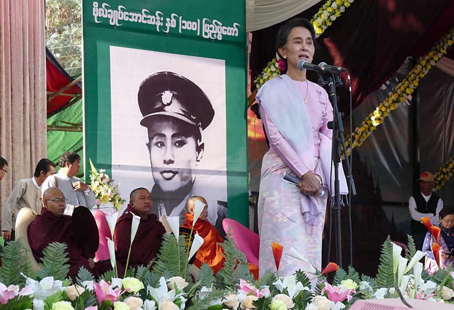 Myanmar Opposition Leader Aung San Suu Kyi speaks during a ceremony to mark the 100th birthday anniversary of her late father, Gen. Aung San, at Nat Mauk township, native place of her father, Magwe Division, central Myanmar, Friday, Feb.13, 2015. Commemorations are held all across the country to celebrate the 100th year birth anniversary of the late independence hero Gen. Aung San, father of Myanmar's democracy icon Aung San Suu Kyi. Photography and painting exhibitions, performances and fairs are being held for several days to mark the 100-year birthday of Aung San. (AP Photo/Khin Maung Win)
