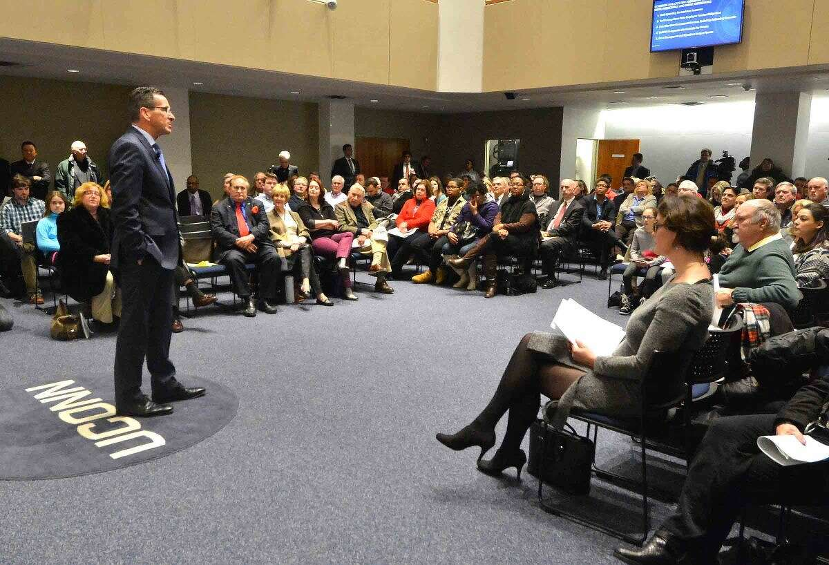 Gov. Dannel P. Malloy talks to a full house at the University of Connecticut's Stamford campus during a Town Hall Meeting in Stamford Thursday night.