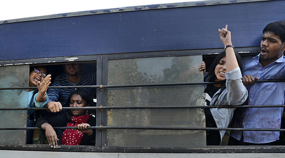 Student activists shout slogans from inside a police van after being detained during a protest against the Hindu Mahasabha, a right-winged Hindu organization, in New Delhi, India, Saturday, Feb. 14, 2015. The Hindu organization had said it would force couples to get married if they were seen together in the open, as this was considered an indecent expression of love. The organization had reportedly posted vigilantes across the city for this purpose. (AP Photo/Shruti Jain)