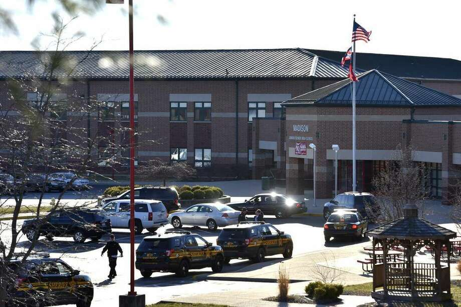 Butler County Sheriff Deputies stand on the scene at Madison Local Schools, Monday, Feb. 29, 2016, in Madison Township in Butler County, Ohio, after a school shooting. An Ohio sheriff says a 14-year-old suspect in the school shooting that wounded multiple classmates is in custody. (Nick Graham/Dayton Daily News via AP)
