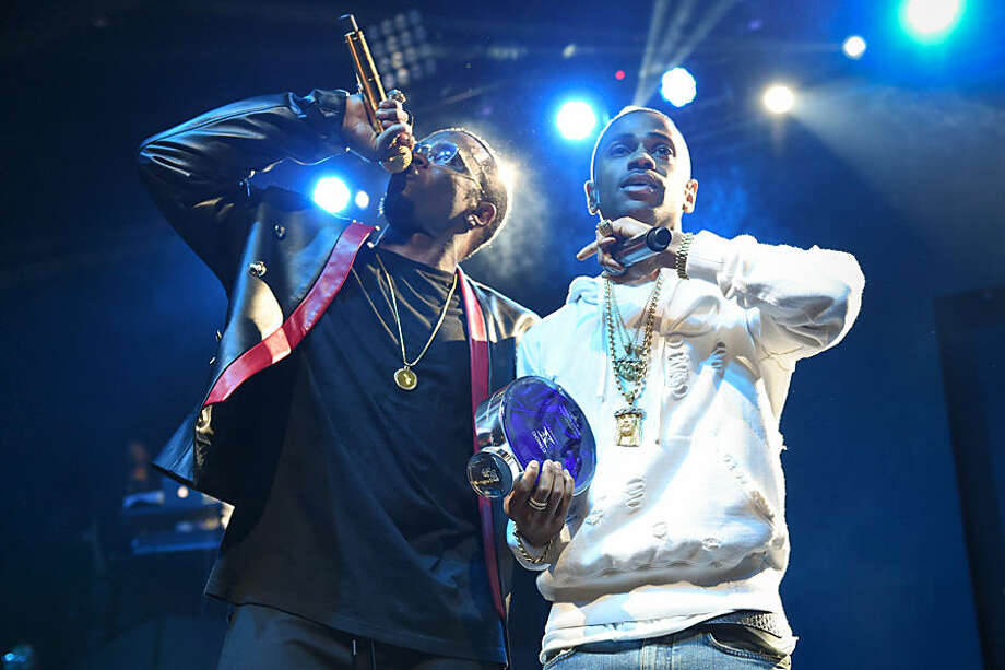 """Rappers Puff Daddy, left, and Big Sean perform at HOT 97's """"The Tip Off"""" at Madison Square Garden on Thursday, Feb. 12, 2015, in New York. (Photo by Scott Roth/Invision/AP)"""
