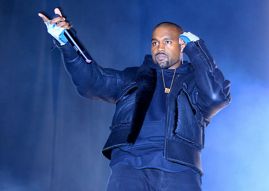 This image released by Starpix shows Kanye West performing at the first annual Roc City Classic in New York's Flatiron District on Thursday, Feb. 12, 2015. (AP Photo/Starpix, Dave Allocca)