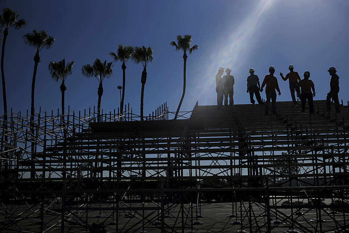 Workers take a short break while setting up the stands for the upcoming Toyota Grand Prix of Long Beach, Friday, Feb. 13, 2015, in Long Beach, Calif. Southern California's heat wave shows no sign of breaking. Temperatures that began rising earlier this week continued to top 80 degrees in many areas on Friday. (AP Photo/Jae C. Hong)