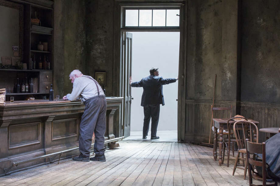 """In this image released by Brooklyn Academy of Music, Brian Dennehy, left, and Nathan Lane appear in a scene from """"The Iceman Cometh"""", performing at the BAM Harvey Theater in the Brooklyn Borough of New York. (AP Photo/Brooklyn Academy of Music, Richard Termine)"""