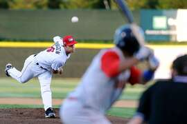 ValleyCats' Daniel Mengden, left, unleashes a pitch during their baseball game against the Brooklyn Cyclones on Friday, Aug. 29, 2014, at Bruno Stadium in Troy, N.Y. (Cindy Schultz / Times Union)