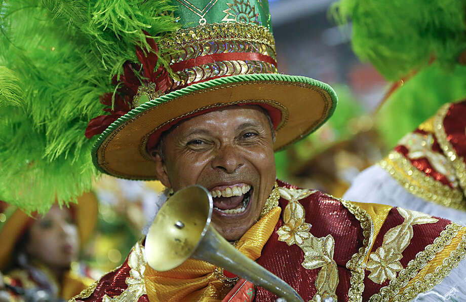 A musician from the Academicos do Tucuruvi samba school performs during the Carnival parade at the Sambodromo in Sao Paulo, Brazil, Friday, Feb. 13, 2015. (AP Photo/Andre Penner)