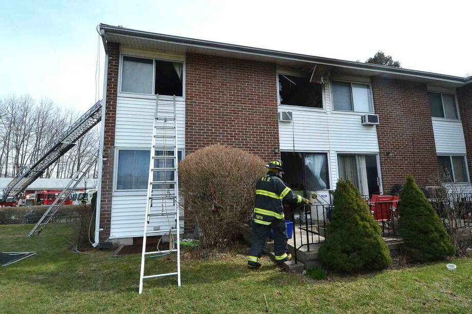 Hour Photo/Alex von Kleydorff Top windows are shattered in a condo in the Nor-West complex in Norwalk after an fire on Wednesday
