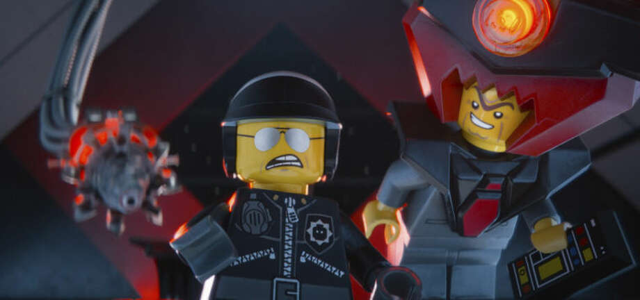 "This image released by Warner Bros. Pictures shows the character Bad Cop/Good Cop, voiced by Liam Neeson, left, and President Business, voiced by Will Ferrell, in a scene from ""The Lego Movie."" (AP Photo/Warner Bros. Pictures)"