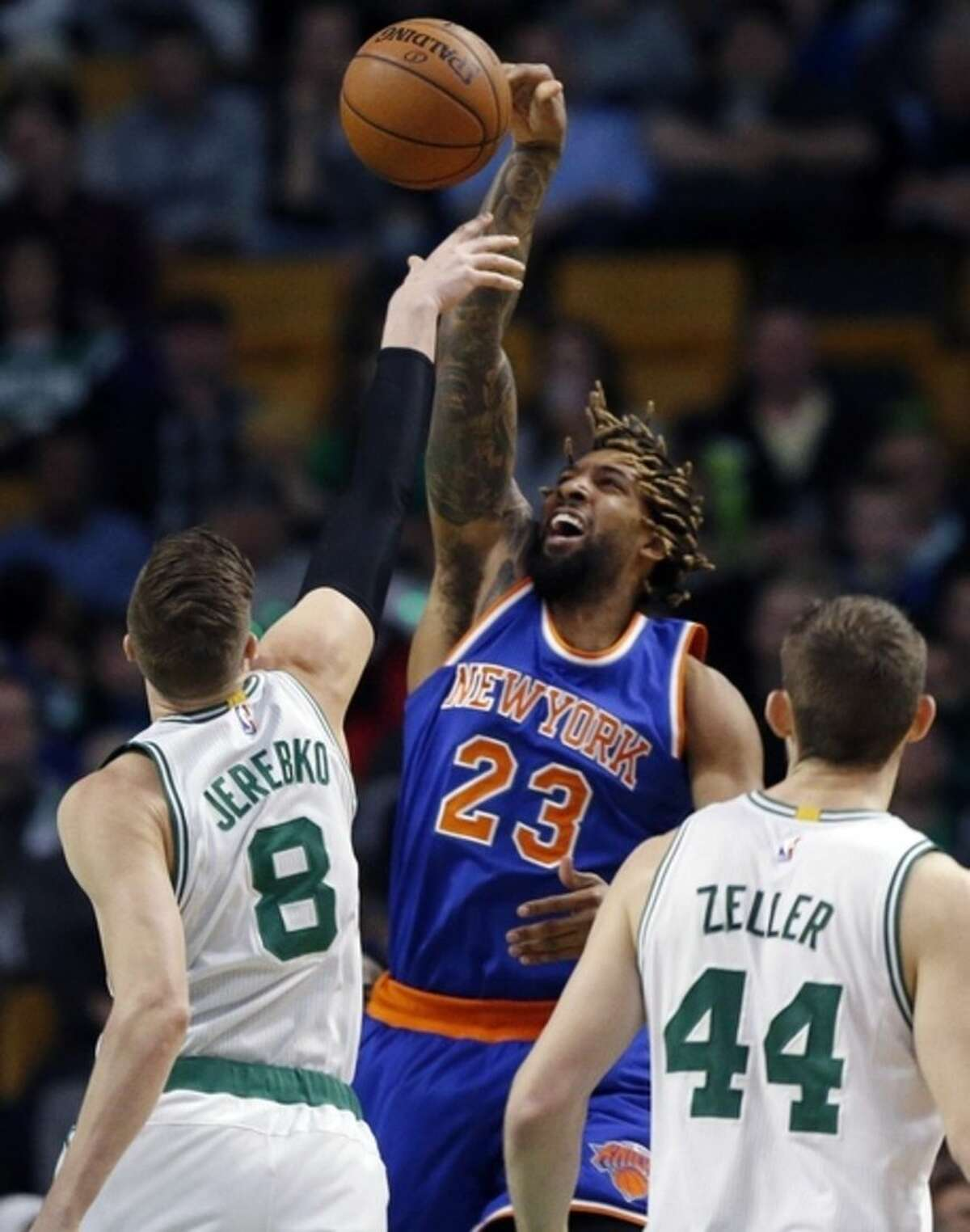 Boston Celtics' Jonas Jerebko (8) blocks a shot by New York Knicks' Derrick Williams (23) during the second quarter of an NBA basketball game in Boston, Friday, March 4, 2016. (AP Photo/Michael Dwyer)