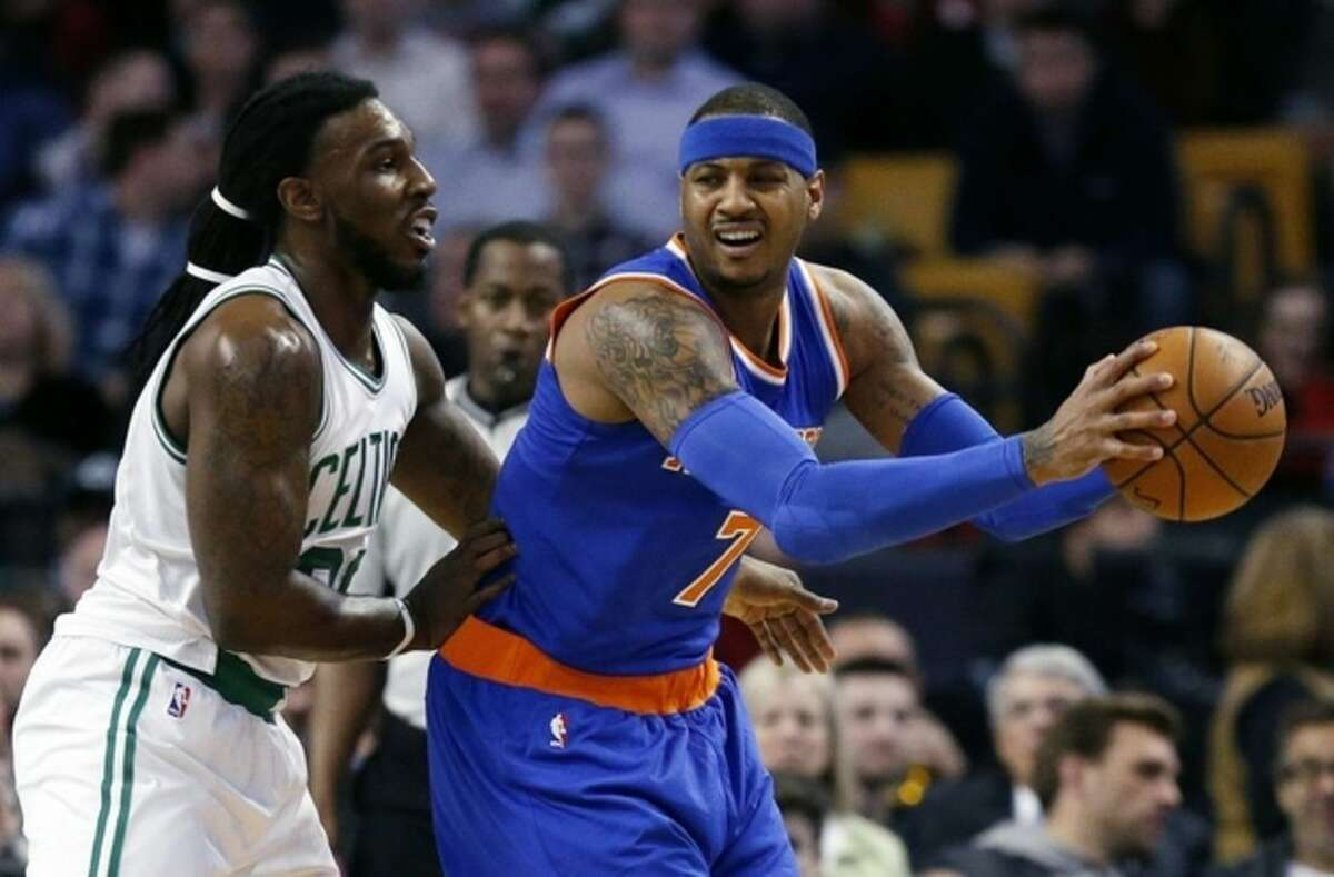 New York Knicks' Carmelo Anthony (7) keeps the ball away from Boston Celtics' Jae Crowder (99) during the first quarter of an NBA basketball game in Boston, Friday, March 4, 2016. (AP Photo/Michael Dwyer)