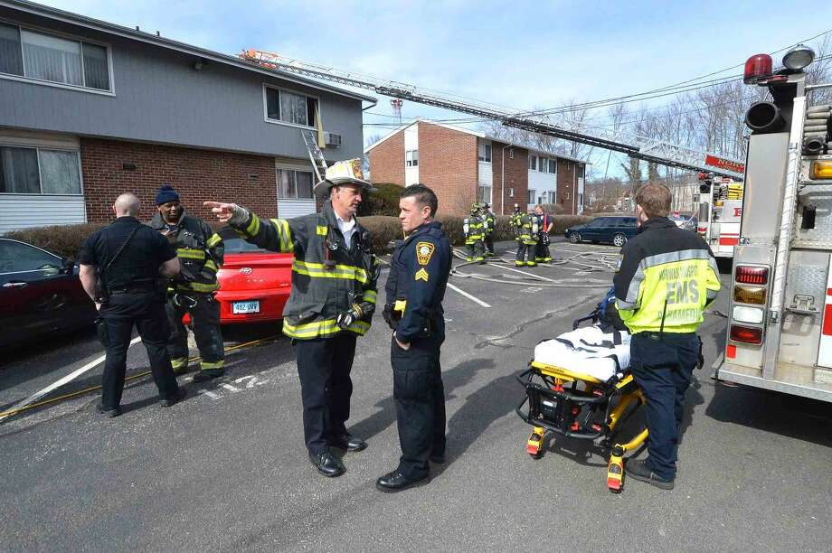 Hour Photo/Alex von Kleydorff Norwalk Fire , Police and Paramedics respond to a fire in a second story condo in the Nor-West complex on County St on Wednesday morning.