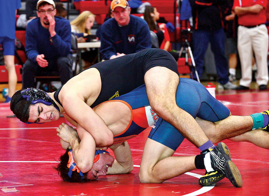 Hour photo / Erik Trautmann Local wrestlers Matt Conte of Westhill and Jeremy Fields of Danubury compete at 120 in the FCIACChampionship meet at New Canaan High School Saturday.