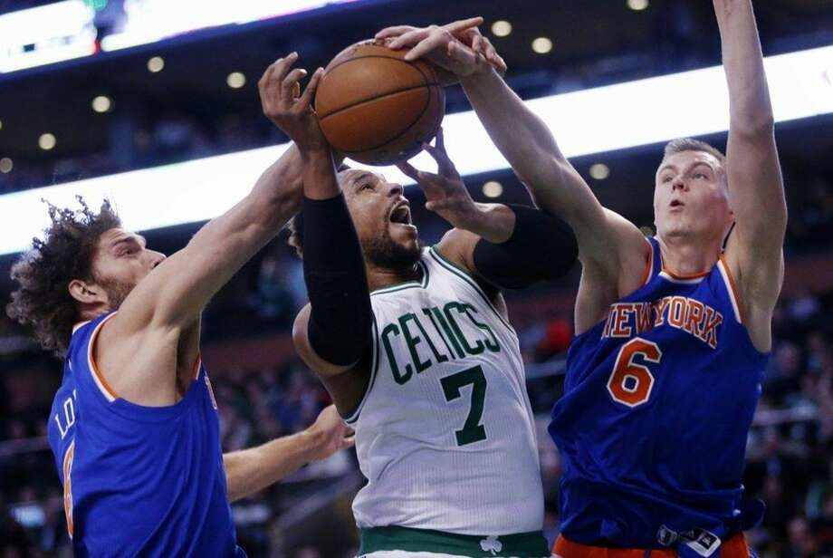 New York Knicks' Kristaps Porzingis (6) blocks a shot by Boston Celtics' Jared Sullinger (7) during the first quarter of an NBA basketball game in Boston, Friday, March 4, 2016. (AP Photo/Michael Dwyer)