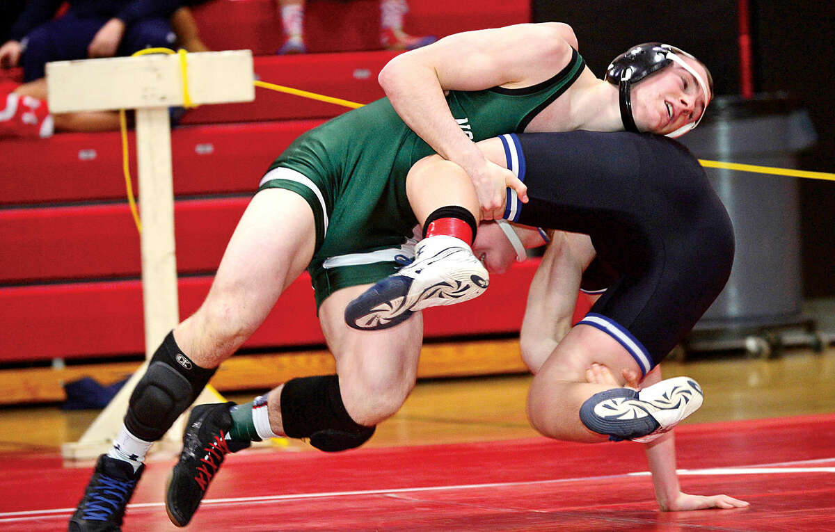 Hour photo / Erik Trautmann Local wrestlers including Connor Halloran of Norwalk compete in the FCIACChampionship meet at New Canaan High School Saturday.
