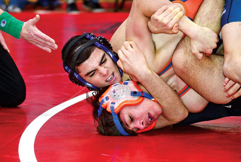Hour photo / Erik Trautmann Local wrestlers Matt Conte of Westhill and Jeremy Fields of Danubury compete at 120 in the FCIAC Championship meet at New Canaan High School Saturday.