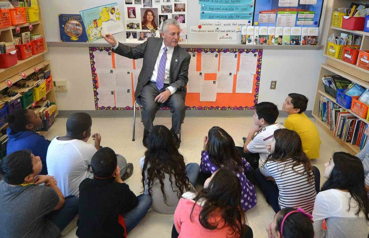 Hour Photo/Alex von Kleydorff Norwalk Mayor Harry Rilling reads Dr, Seuss' Sneetches to kids during Read Across America day at Brookside School