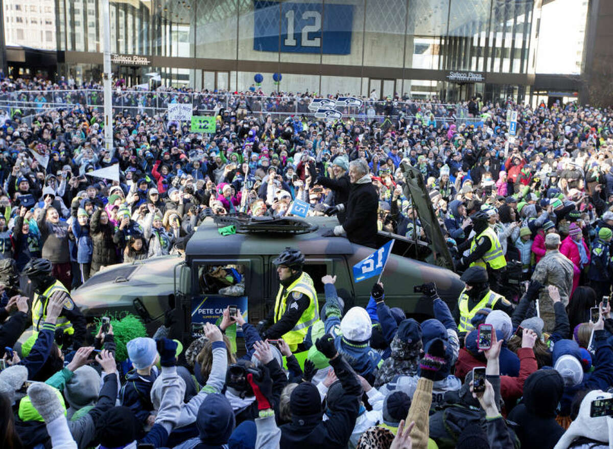 Seattle Seahawks coach Pete Carroll waves to the crowd during a parade for the NFL football Super Bowl champions on Wednesday, Feb. 5, 2014, in Seattle. The Seahawks defeated the Denver Broncos in Super Bowl XLVIII on Sunday. (AP Photo/The Seattle Times, Steve Ringman) SEATTLE OUT, USA TODAY OUT MAGS OUT NO SALES TV OUT MANDATORY CREDIT