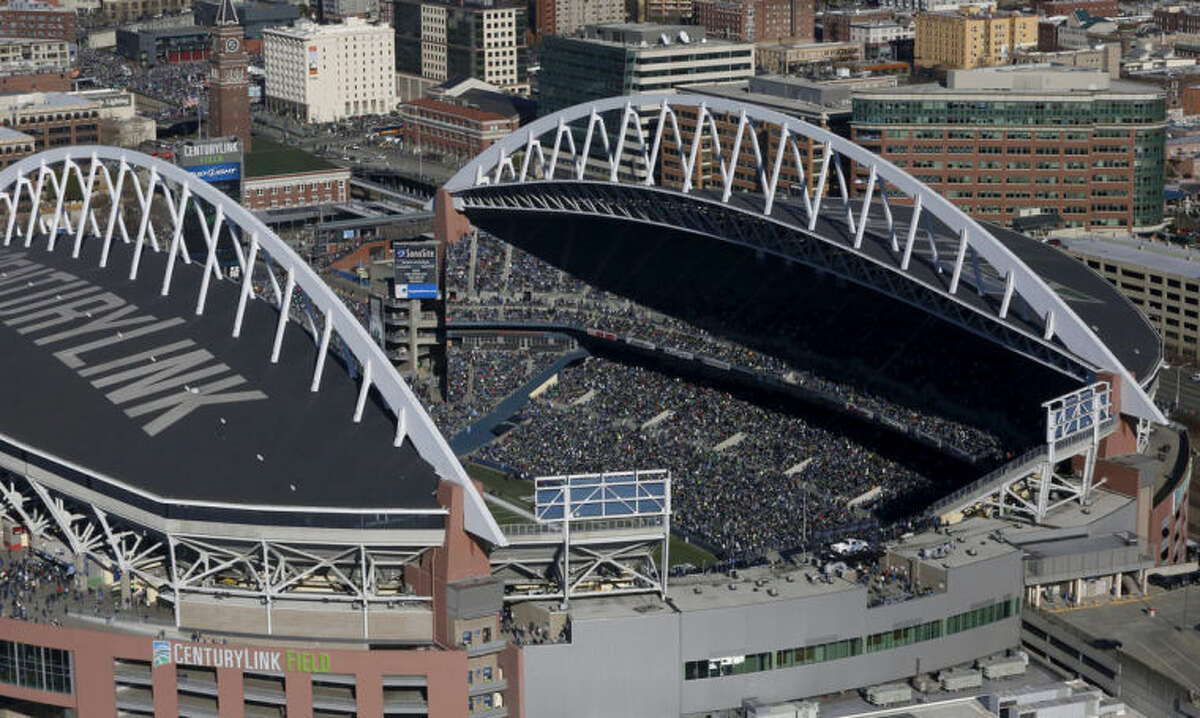 People crowd CenturyLink Field to watch the parade for the NFL football Super Bowl champions, Wednesday, Feb. 5, 2014, in Seattle. The Seahawks defeated the Denver Broncos 43-8 on Sunday. (AP Photo/The Seattle Times, Alan Berner) OUTS: SEATTLE OUT, USA TODAY OUT, MAGAZINES OUT, TELEVISION OUT, SALES OUT. MANDATORY CREDIT