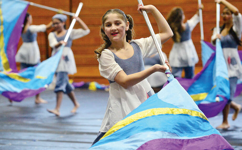 Hour photo / Erik Trautmann Lisa Goodchild performs The Hard Knock Life with the Norwalk Scholastic AAA Winter Guard at the Musical Arts Conference for Winter Guard and Percussion saturday at Norwalk High School.
