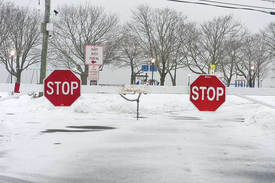Hour photo / Erik Trautmann Calf Pasture Beach was closed ahead of the snowstorm Saturday evening.