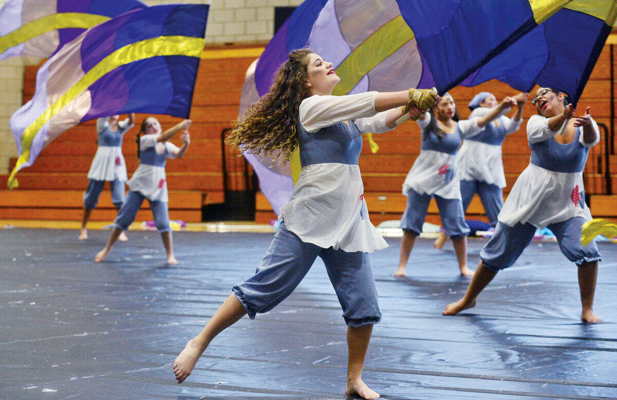 Hour photo / Erik Trautmann Tessa Neilsen performs The Hard Knock Life with the Norwalk Scholastic AAA Winter Guard at the Musical Arts Conference for Winter Guard and Percussion saturday at Norwalk High School.