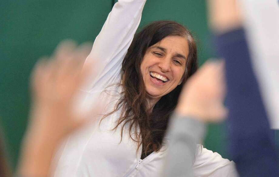 Hour Photo/Alex von Kleydorff Nina Antolino gets the kids moving with Yoga 4 Kids during Celebrate the Arts at Fox Run School