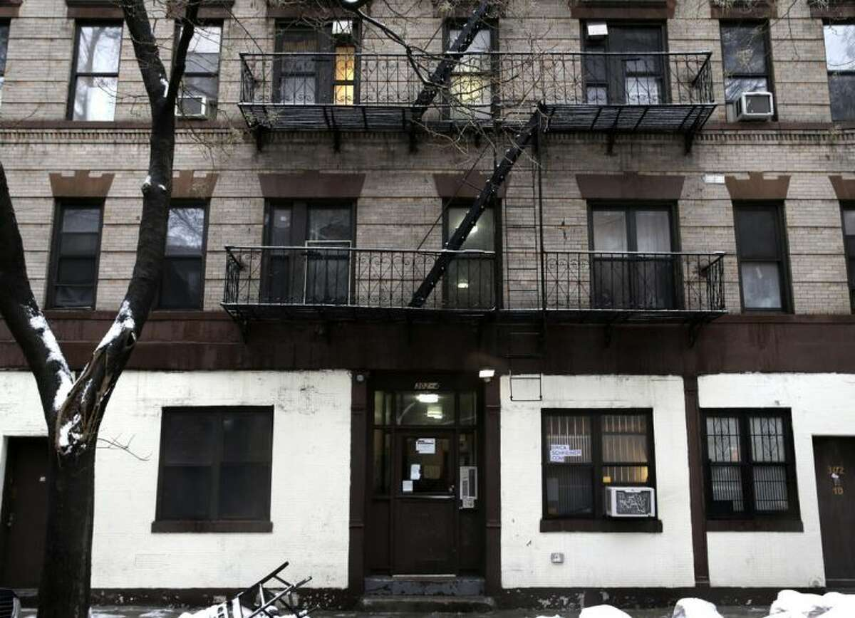 The building at 320 Mott St. is seen in New York, Wednesday, Feb. 5, 2014. Four people are in custody on drug charges after police executed search warrants at three apartments in the building. (AP Photo/Seth Wenig)