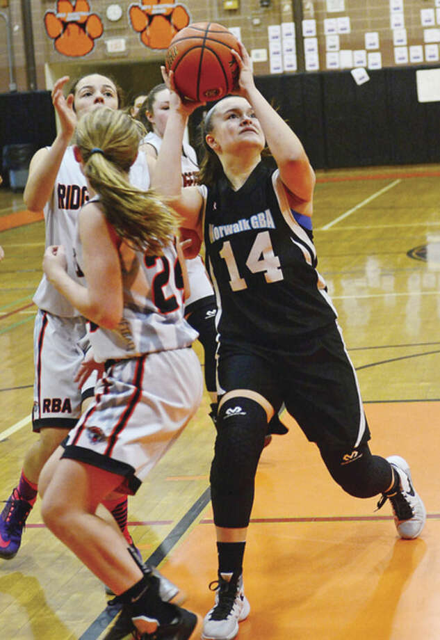 Hour photo / Erik TrautmannNorwalk eighth grade girls basketball player Emily Potochney looks to score against Ridgefield Saturday.