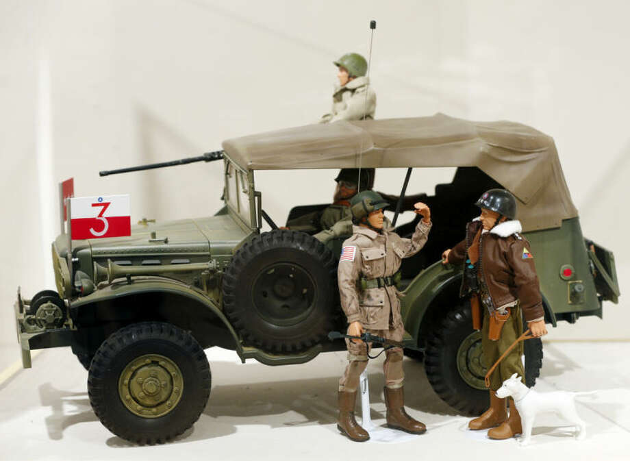 This Jan. 31, 2014 photo shows a Gen. George Patton G.I. Joe action figure, right, and other G.I. Joes in a display at the New York State Military Museum in Saratoga Springs, N.Y. A half-century after the 12-inch doll was introduced at a New York City toy fair, the iconic action figure is being celebrated by collectors with a display at the military museum, while the toy's maker plans other anniversary events to be announced later this month. (AP Photo/Mike Groll)
