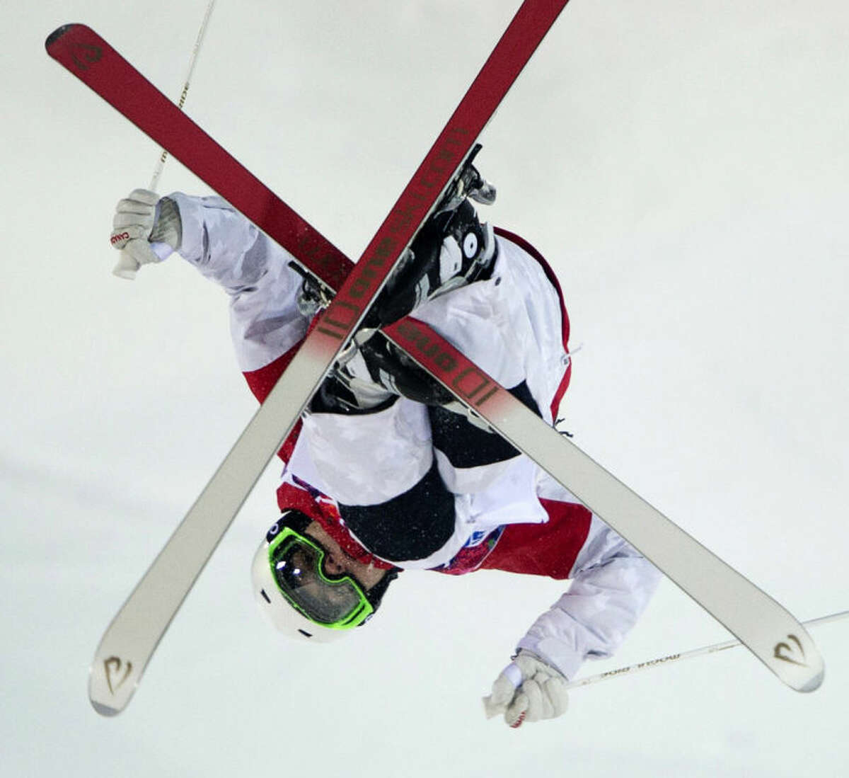 Canada's moguls skier Mikael Kingsbury flies over a jump during freestyle skiing training run at the 2014 Sochi Winter Olympics in Krasnaya Polyna, Russia, Wednesday, Feb. 5, 2014. (AP Photo/The Canadian Press, Jonathan Hayward)