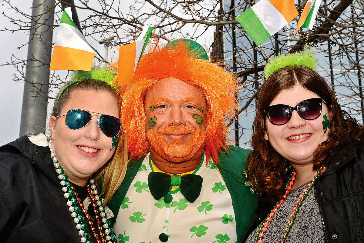 Hour photo / Erik Trautmann Kacie Thompson, Charles Pia and Amanda Foster celebrate during the 2016 Stamford St. Patrick's Day Parade Saturday.