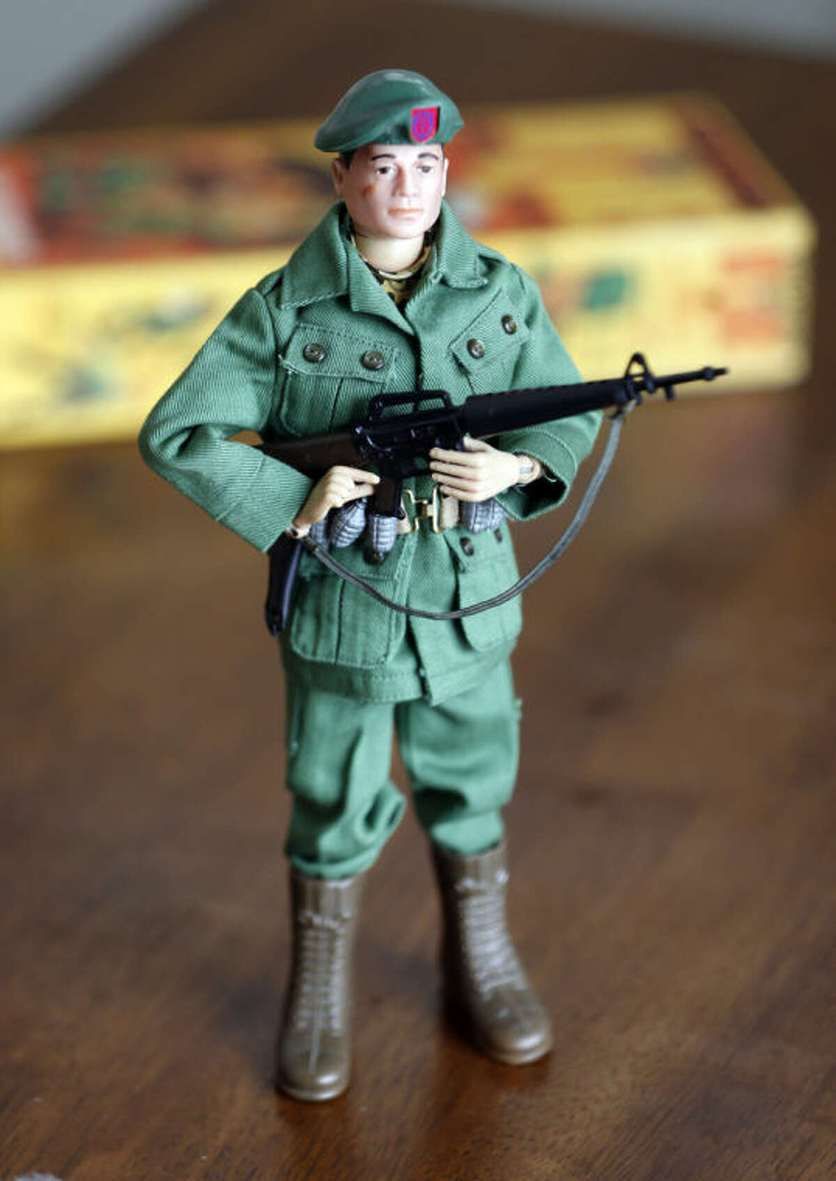 This Jan. 31, 2014 photo shows one of Tearle Ashby's G.I. Joe action figures in Niskayuna, N.Y. A half-century after the 12-inch doll was introduced at a New York City toy fair, the iconic action figure is being celebrated by collectors with a display at the New York State Military Museum, while the toy's maker plans other anniversary events to be announced later this month. (AP Photo/Mike Groll)