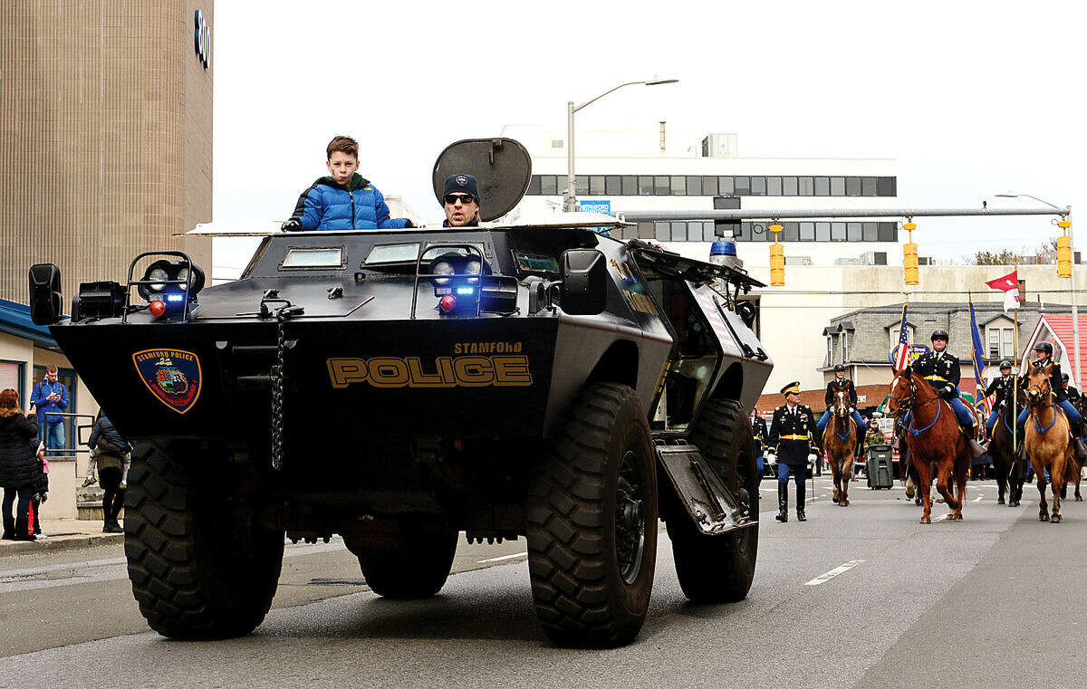 Hour photo / Erik Trautmann The Stamford Police Department rolls out their armored vehicle during the 2016 Stamford St. Patrick's Day Parade Saturday.