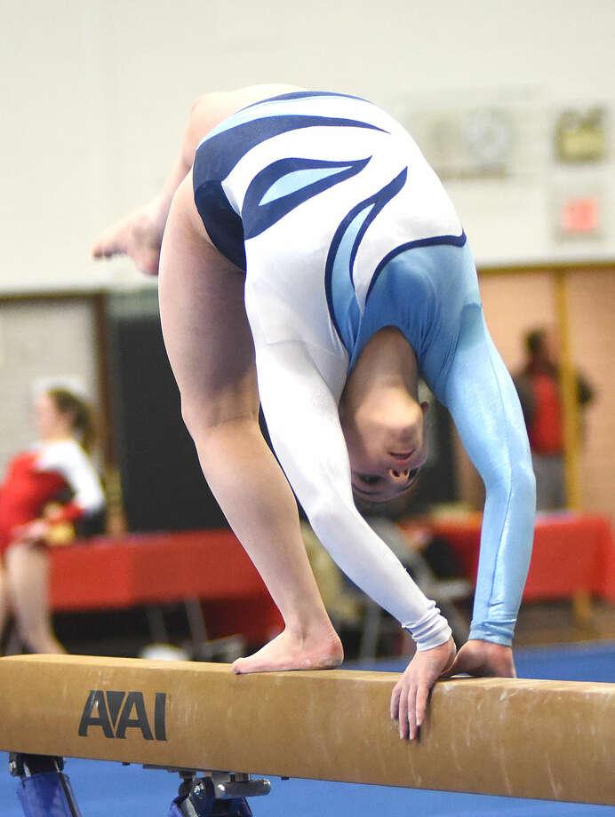 Hour photo/John Nash - Action from Saturday's FCIAC Gymnastics Championship meet at Jonathan Law High School in Milford.