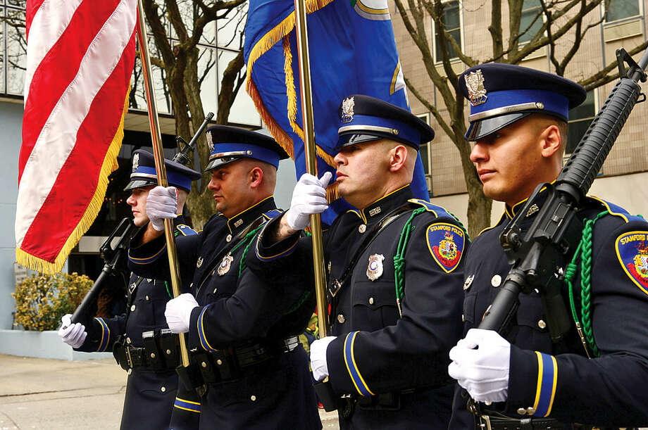 Hour photo / Erik Trautmann The Stamford Police Department Honor Guard leads the 2016 Stamford St. Patrick's Day Parade Saturday.