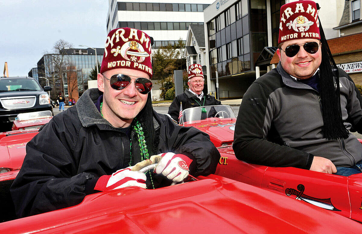Hour photo / Erik Trautmann Ptramid Shriners Rich Gross and Derek Dambria drive the little cars during the 2016 Stamford St. Patrick's Day Parade Saturday.