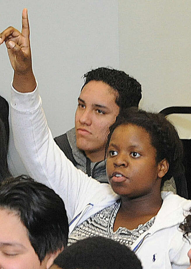 Nahomie Eugene, 15, asks a question Monday at the Stamford YMCA, where police hosted a seminar that walked youths through a number of scenarios that could occur in encounters with officers.