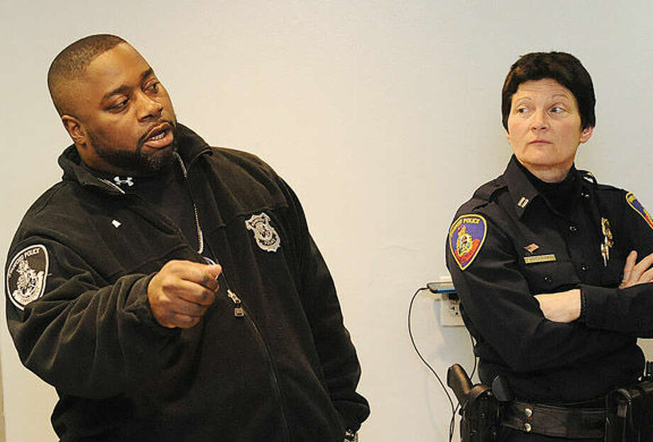 Stamford Police Officer Kenny Boyd and Capt. Susan Bretthauer Monday at the Stamford YMCA, where police hosted a seminar that walked youths through a number of scenarios that could occur in encounters with officers.