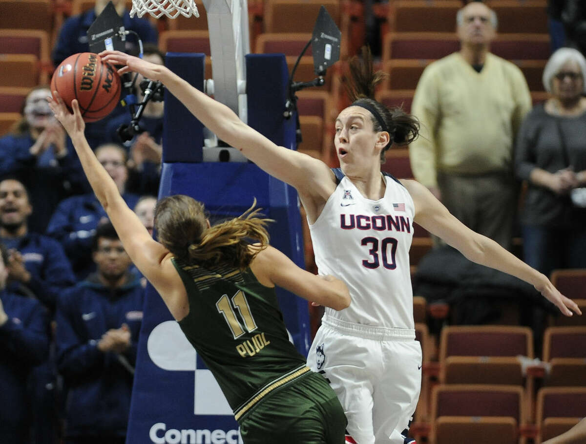 Connecticut's Breanna Stewart blocks a shot attempt by South Florida's Ariadna Pujol, left, during the first half of an NCAA college basketball game in the American Athletic Conference tournament finals at Mohegan Sun Arena, Monday, March 7, 2016, in Uncasville, Conn. (AP Photo/Jessica Hill)