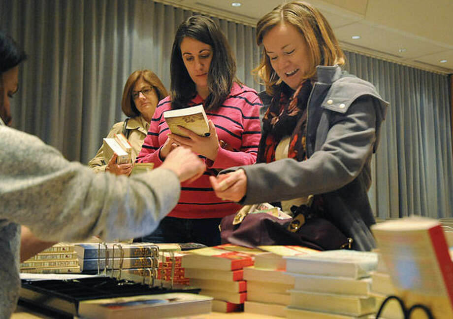"Kristin Thorvaldsen and Liz Collins purchase copies of ""The Fall of Poppies, Stories of Love and The Great War."""